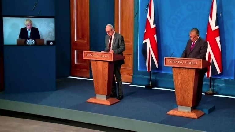 Boris Johnson, who is isolating, leads a COVID news conference on 19 July